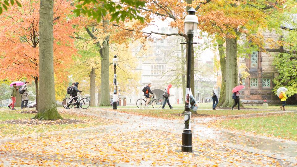 People walking across campus in autumn