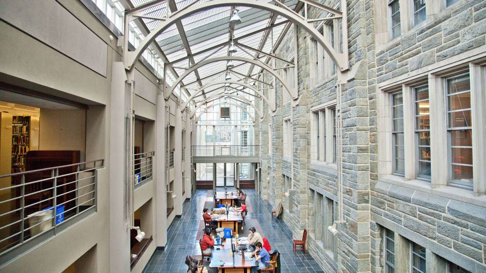 Students study in Firestone Library under skylight