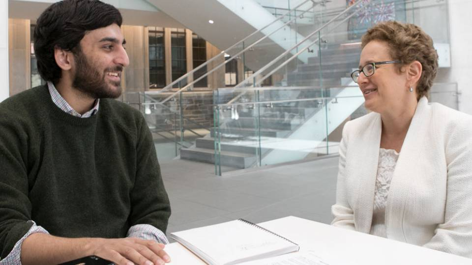Nabil Shaikh '17 with senior thesis advisor, Professor Melissa Lane, in the cafe of the Simpson International Building