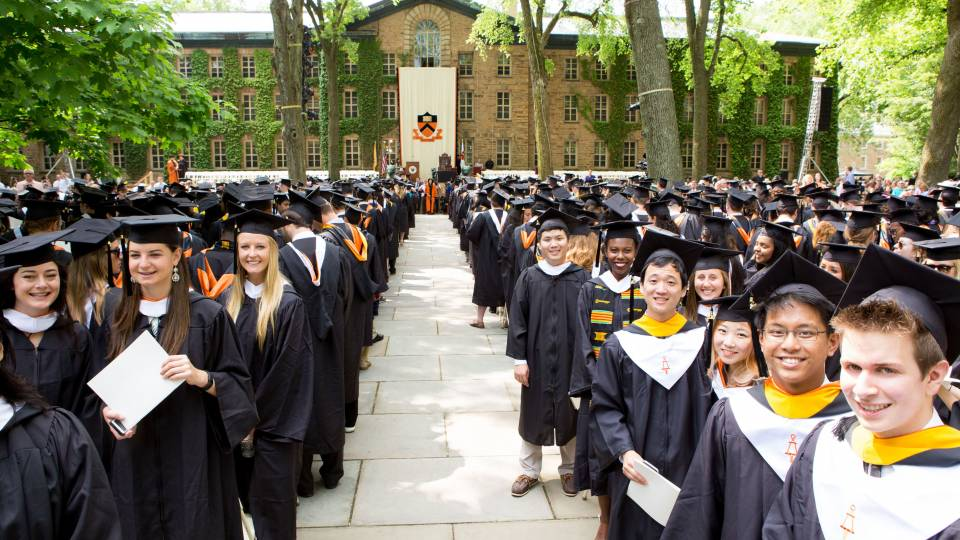 Students standing in front of Nassau Hall for Commencement