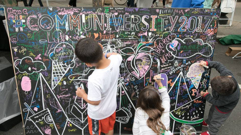 The annual Communiversity Artsfest includes arts and crafts demonstrations and activities ranging from tissue paper flowers to oil painting. Above, children add their own artistic flourishes to a Communiversity sign.
