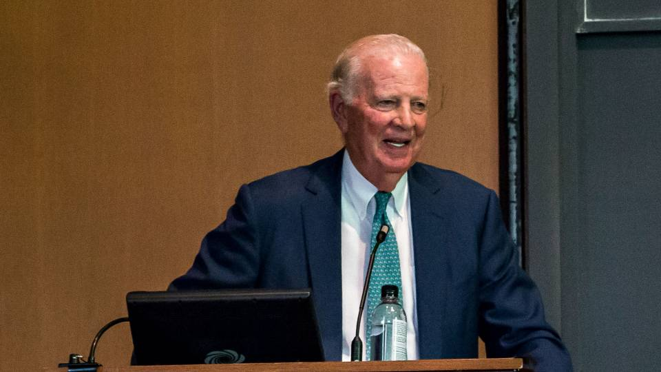 James Baker at podium giving Taplin lecture