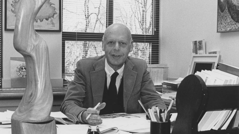 William Baumol at desk