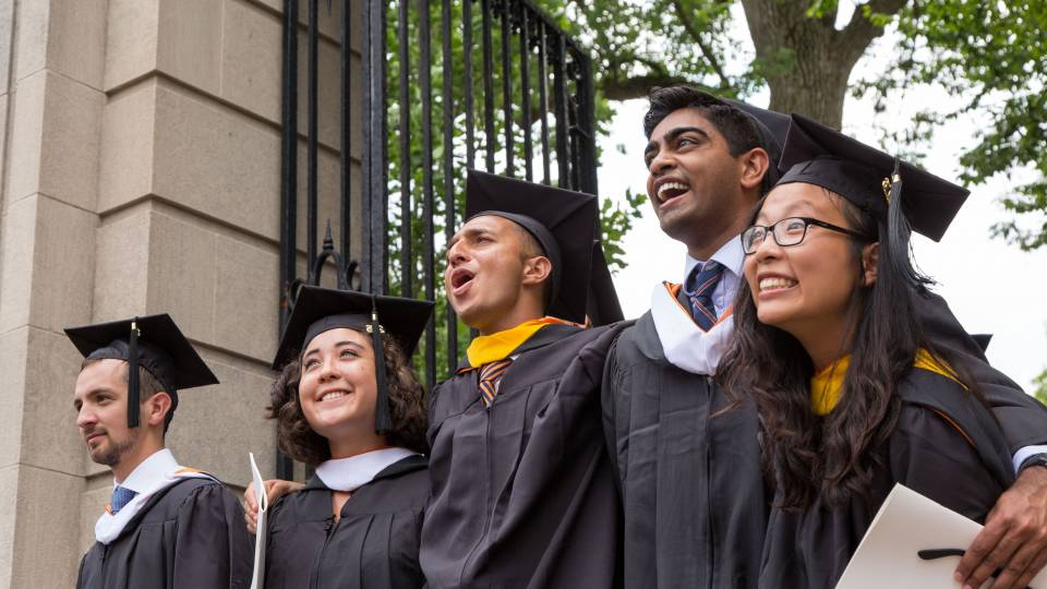 Students exiting FitzRandolph Gate after graduation