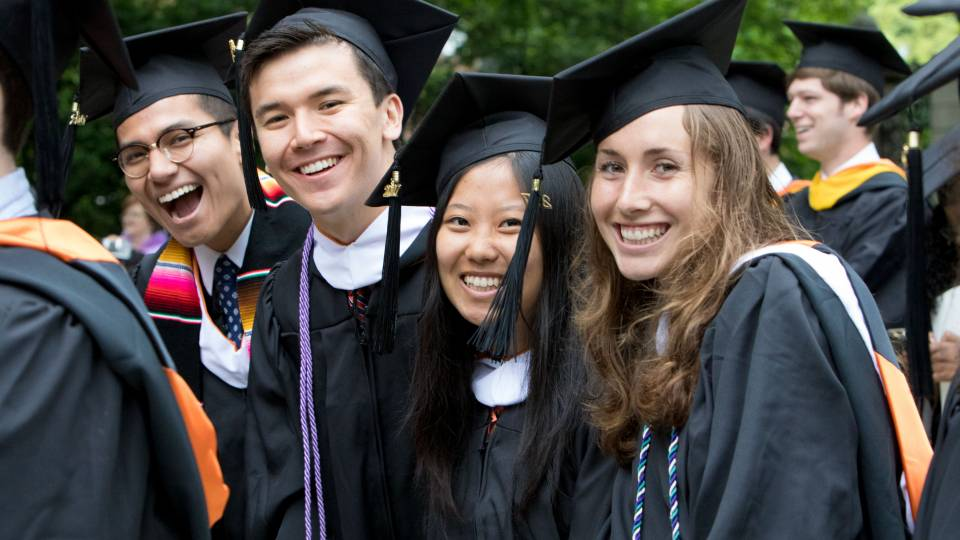 Students smiling during Commencement 2017 ceremony