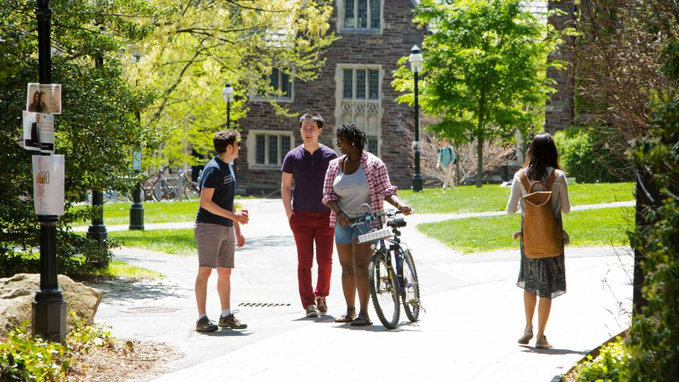 students walking along path through campus