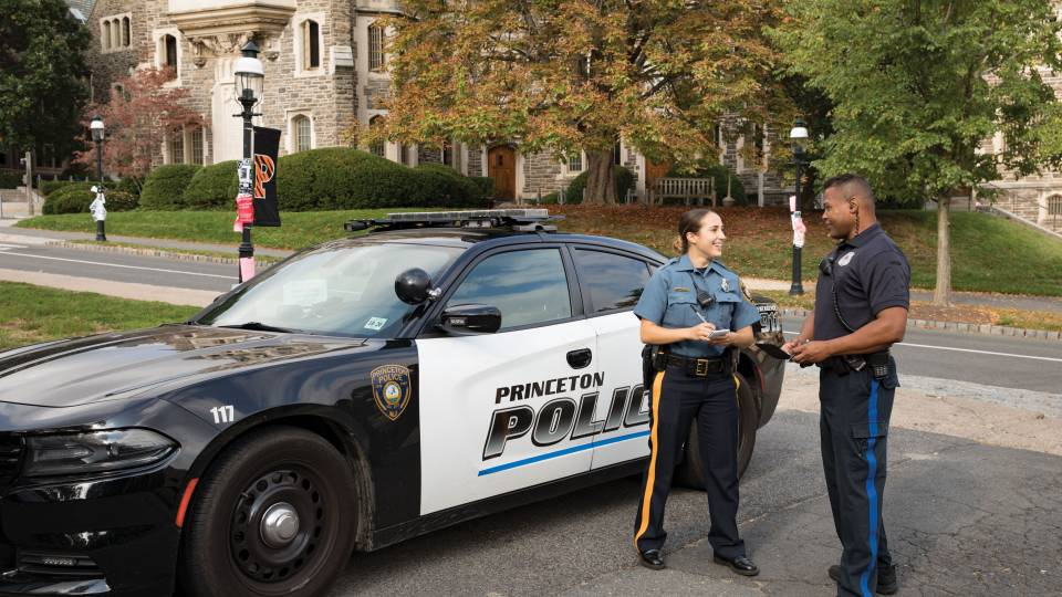Princeton Police Department Patrol Officer Ashley Gaylord and Department of Public Safety Lieutenant David Tricoche standing by police car