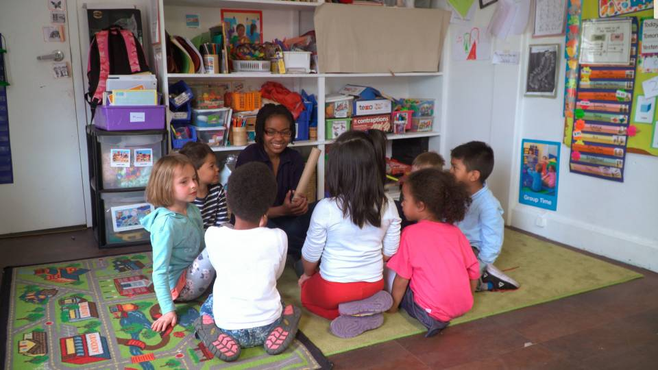 Jazmyn Blackburn teaching nursery school students