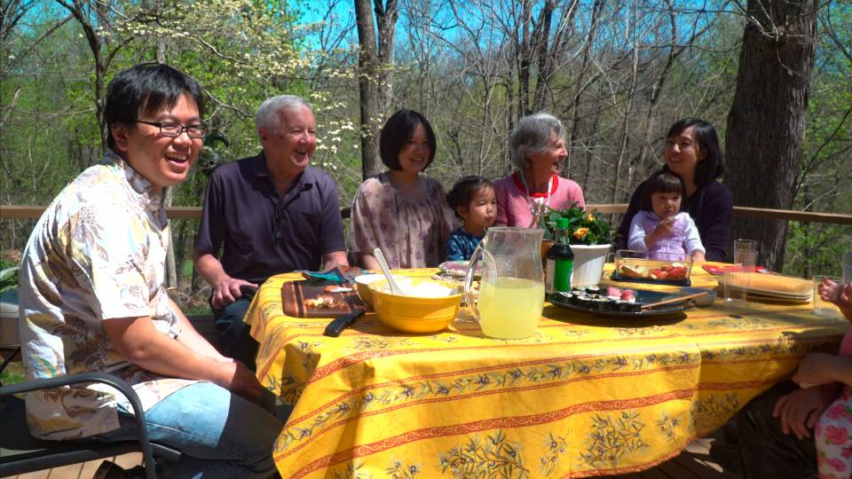 So Kubota with his family and host family eating outside
