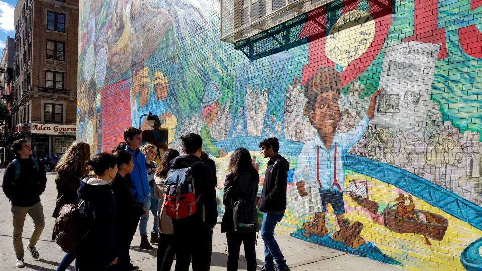 Students looking at mural in New York City