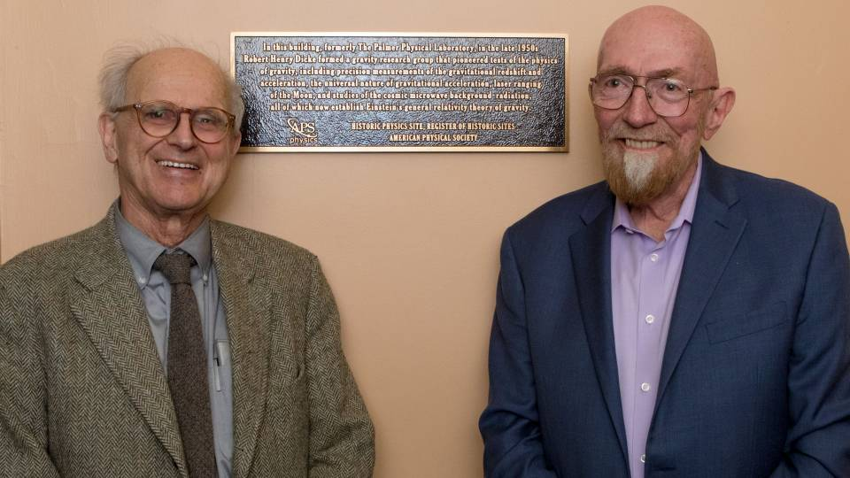"Rainer Weiss and Kip Thorne stand next to a plaque commemorating physics work of Robert ""Bob"" Dicke"