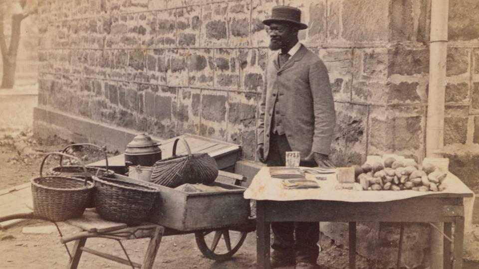 James Johnson standing by table outside Nassau Hall circa 1881