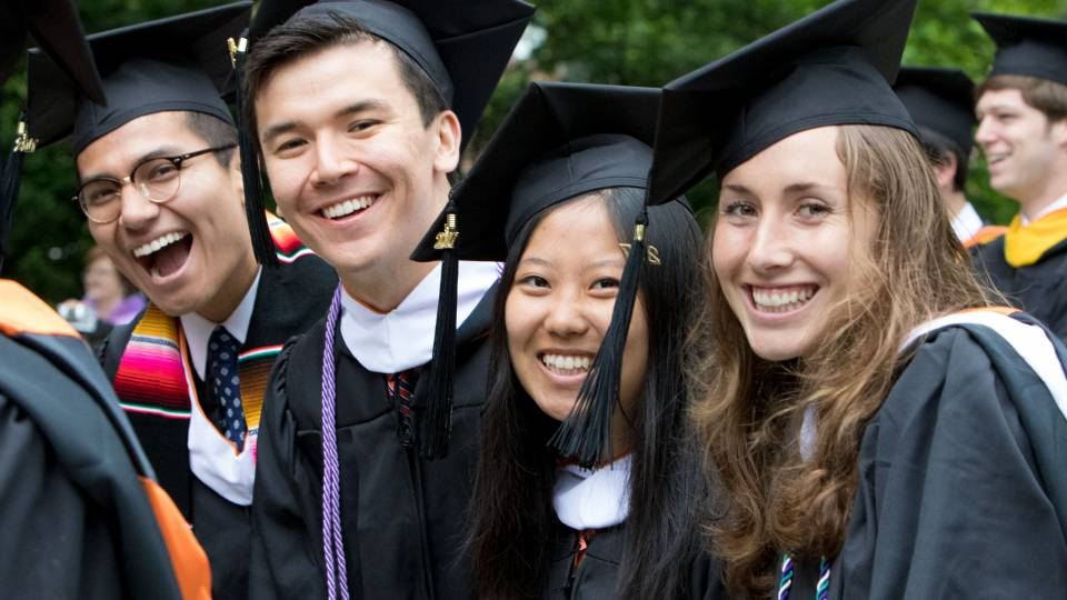 Students smiling at Commencement