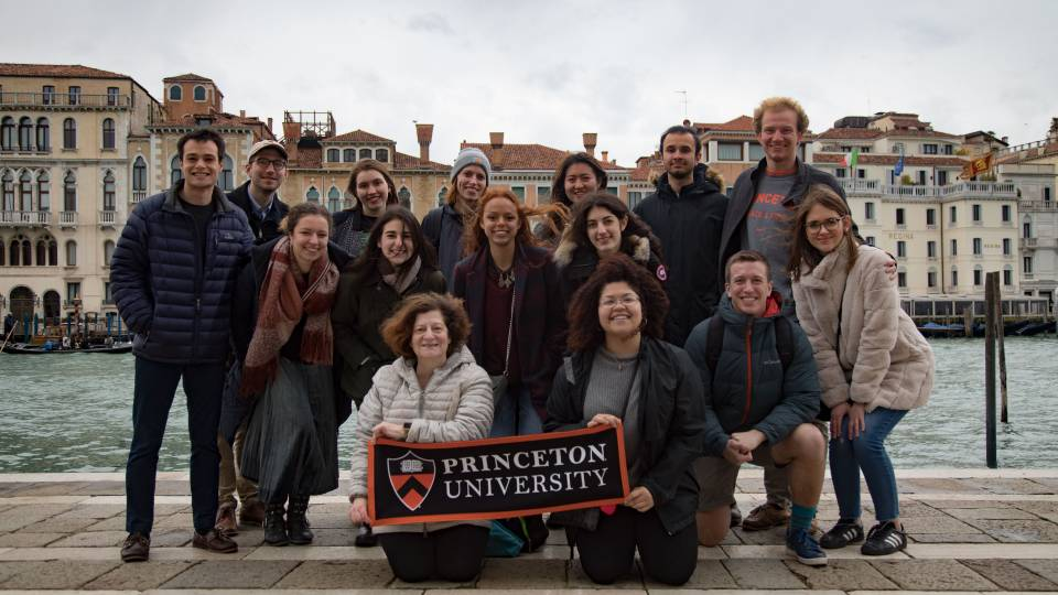 Students and professors in Venice holding Princeton University banner