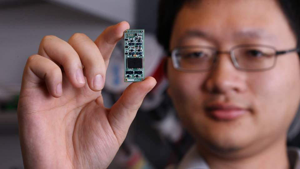 Minjie Chen holds a Power Converter chip
