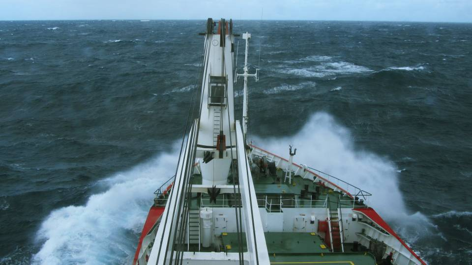 A research vessel plows through choppy water off the coast of South Africa