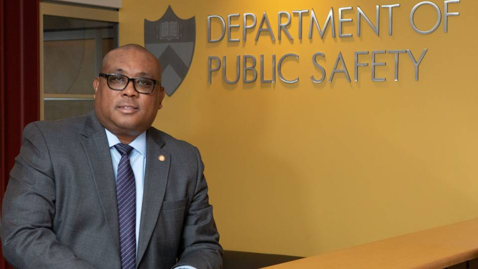 Kenneth Strother Jr standing by Department of Public Safety sign