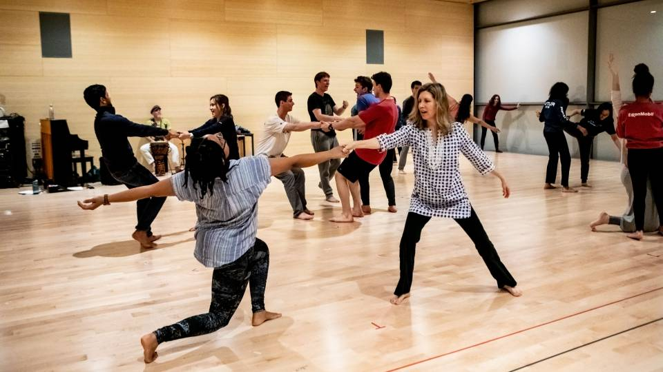 Students and faculty dancing in dance class