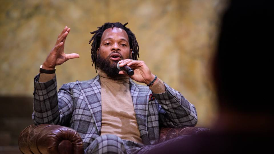Michael Bennett speaks on stage