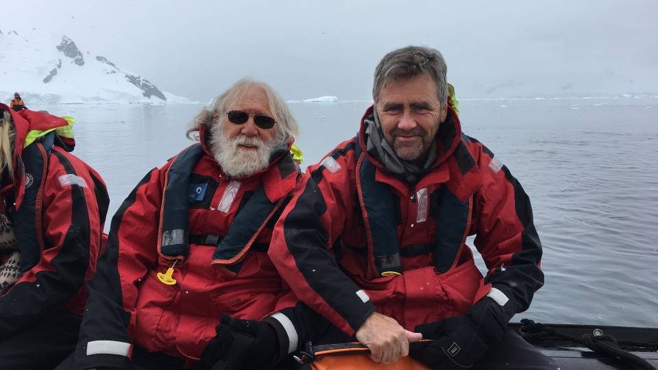 Charlie Gross and Tom Albright sitting in a boat in Antarctica