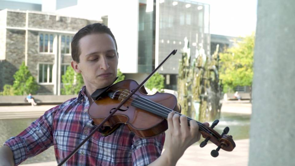 Austin Berman playing violin