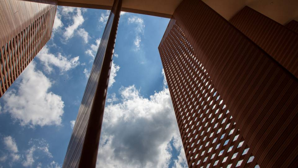 Slats with cloudy blue sky behind them
