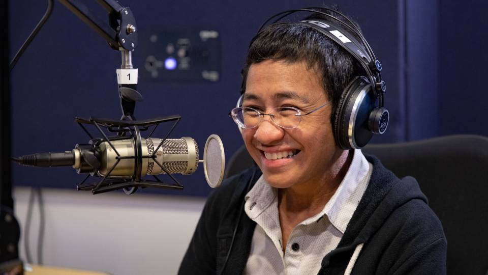 Maria Ressa in a recording booth