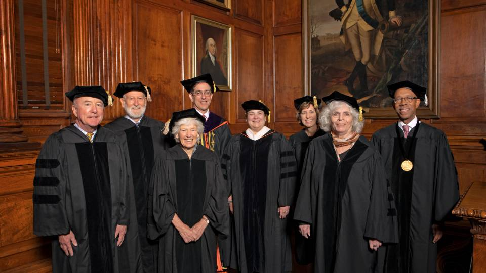 Recipients of honorary degrees pose in their ceremonial robes and mortarboards