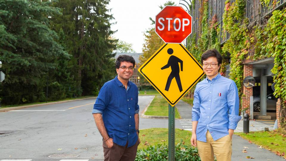 Researchers next to a stop sign