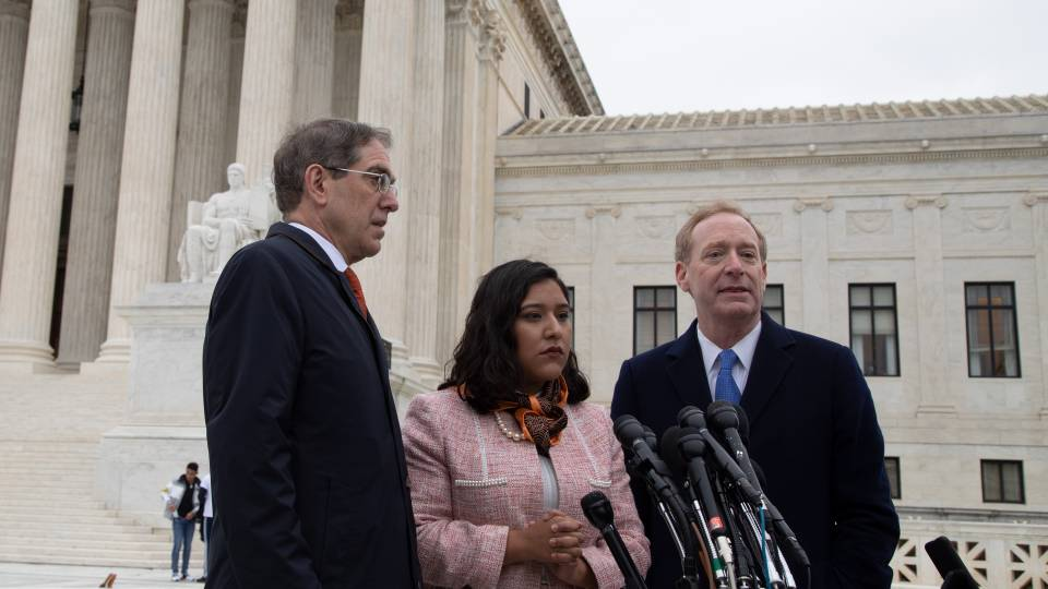 Christopher Eisgruber, Brad Smith and Maria Perales S nchez on the steps of the Supreme Court building in Washington, D.C.