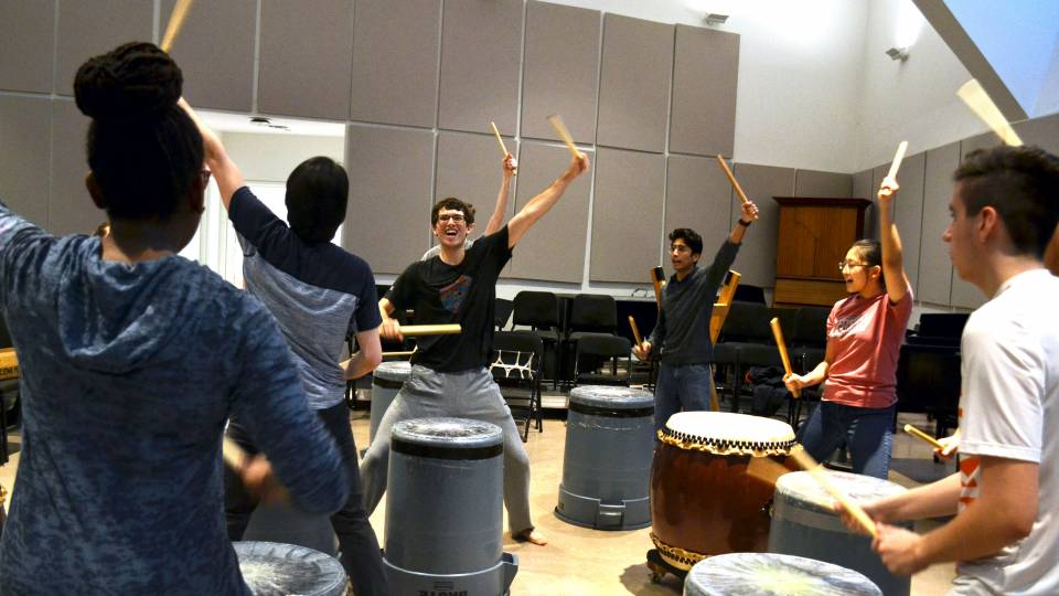 Students drumming enthusiastically