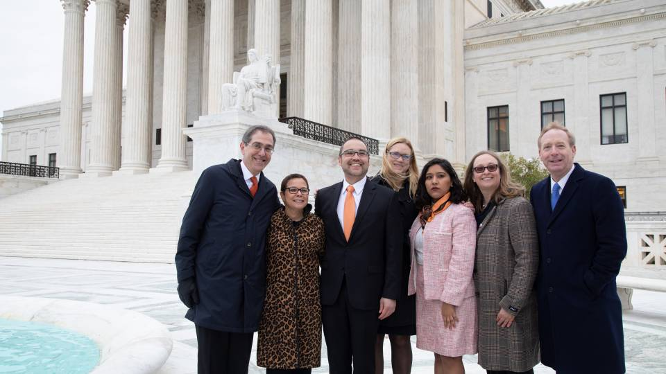 Eisgruber, Romero, Sanchez, Smith, and legal team pose in front of the Supreme Court building