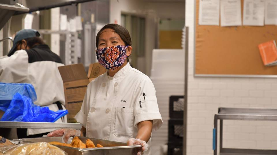 Campus Dining employee smiles