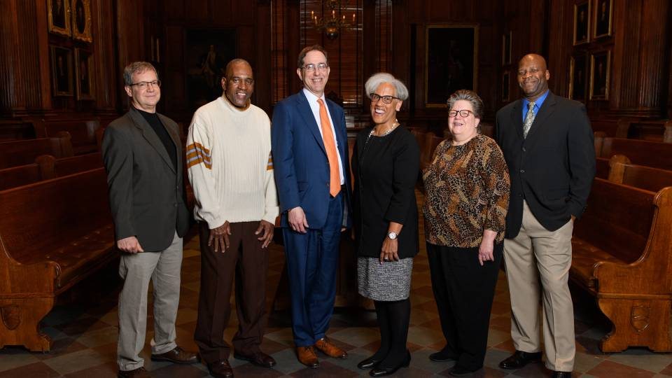 President Eisgruber poses with outstanding staff members honored for their service
