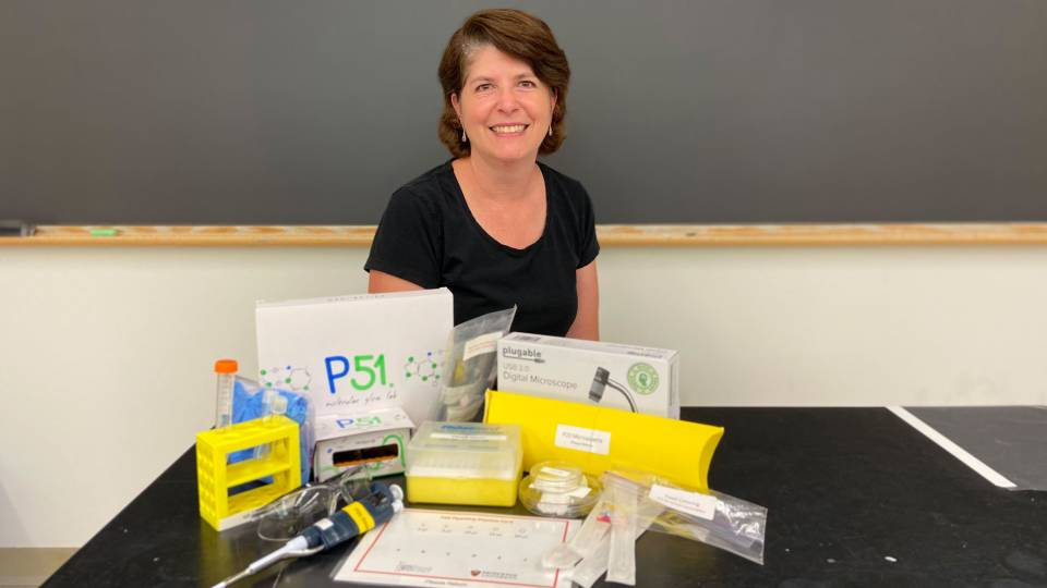 Heather Thieringer poses with science equipment