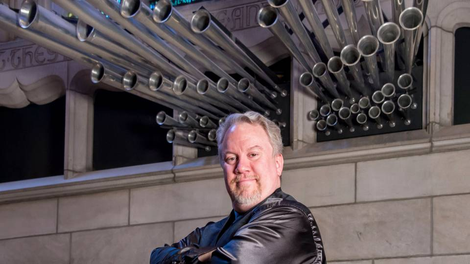 Eric Plutz in front of organ pipes