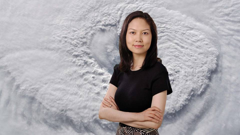 Ning Lin with a hurricane superimposed behind her