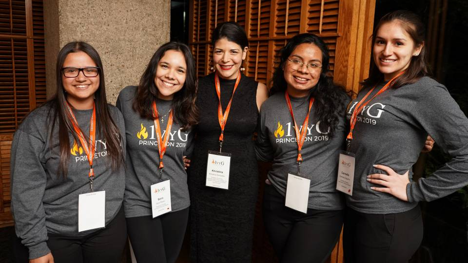 Khristina Gonzalez poses with conference attendees