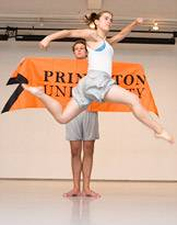 dancer jumping in front of Princeton banner
