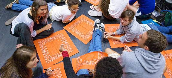 circle of students with handkerchiefs