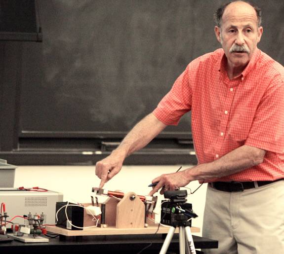 Professor Littman points to each end of a lever