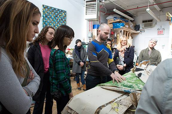Artist at Work Jonathan VanDyke with students in his studio