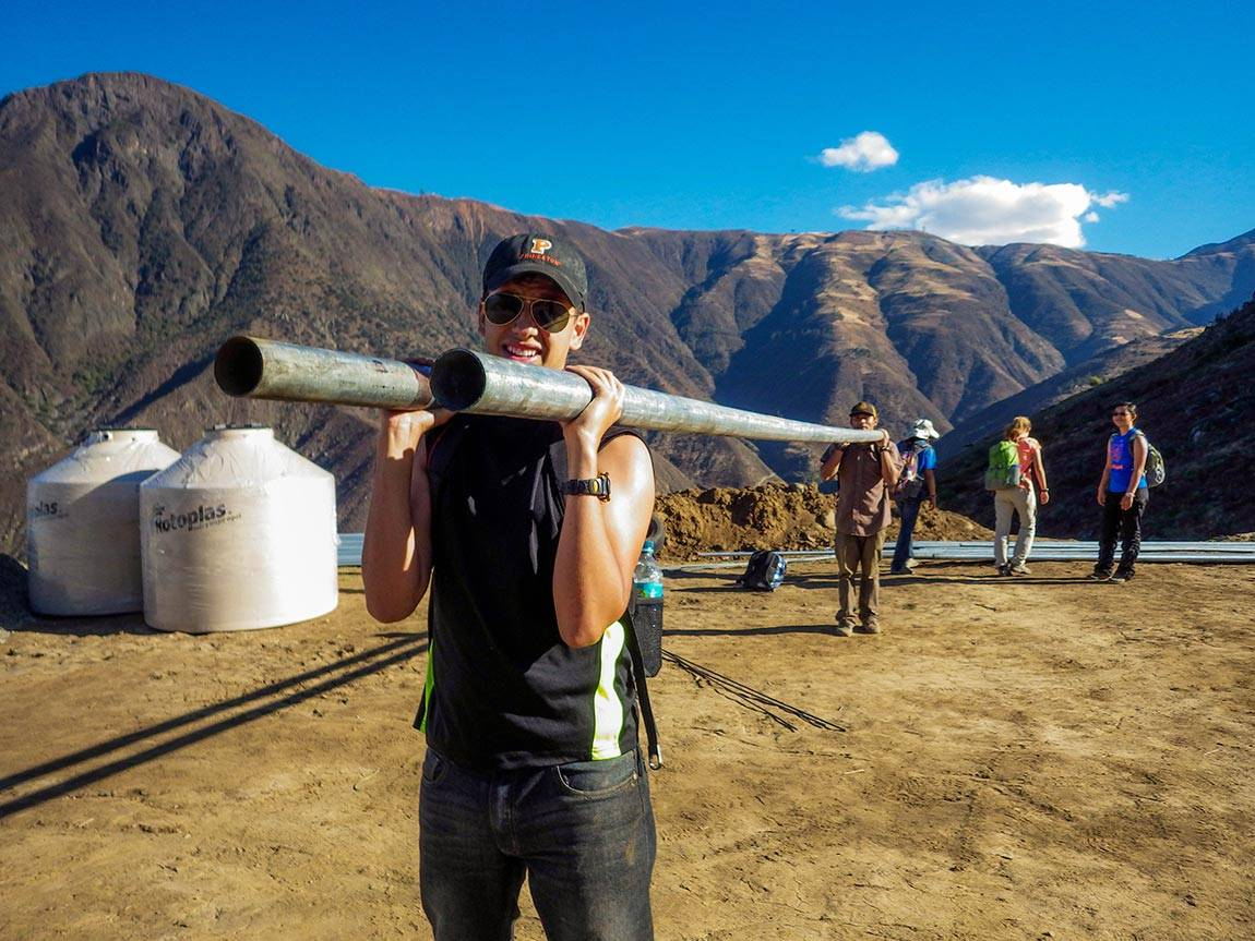 Engineers Without Borders students: In one EWB project, Will Guiracoche, now a junior, helped carry pipes up a mountain to install a system for delivering fresh water to the town of La Pitajaya in the summer of 2014.