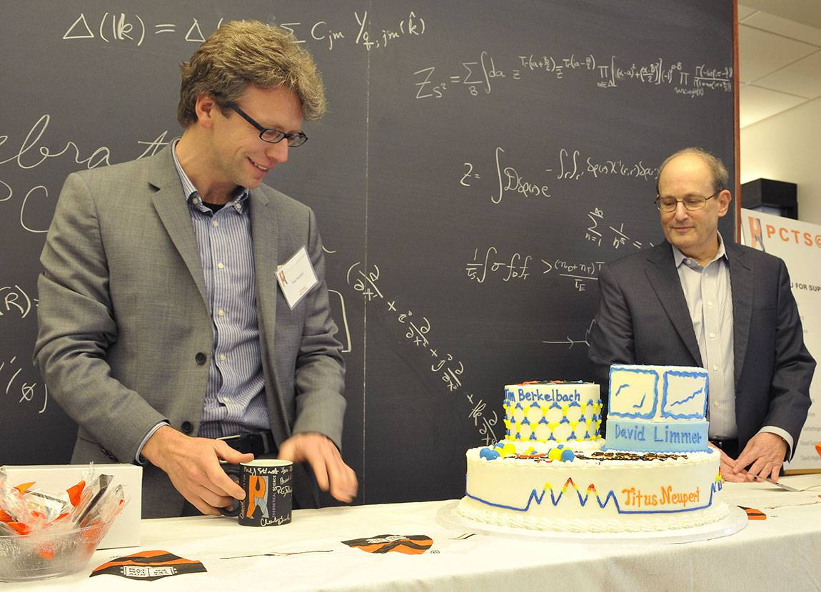Titus Newport and PCTS director Paul Steinhart with a a cake decorated with designs drawn from their research