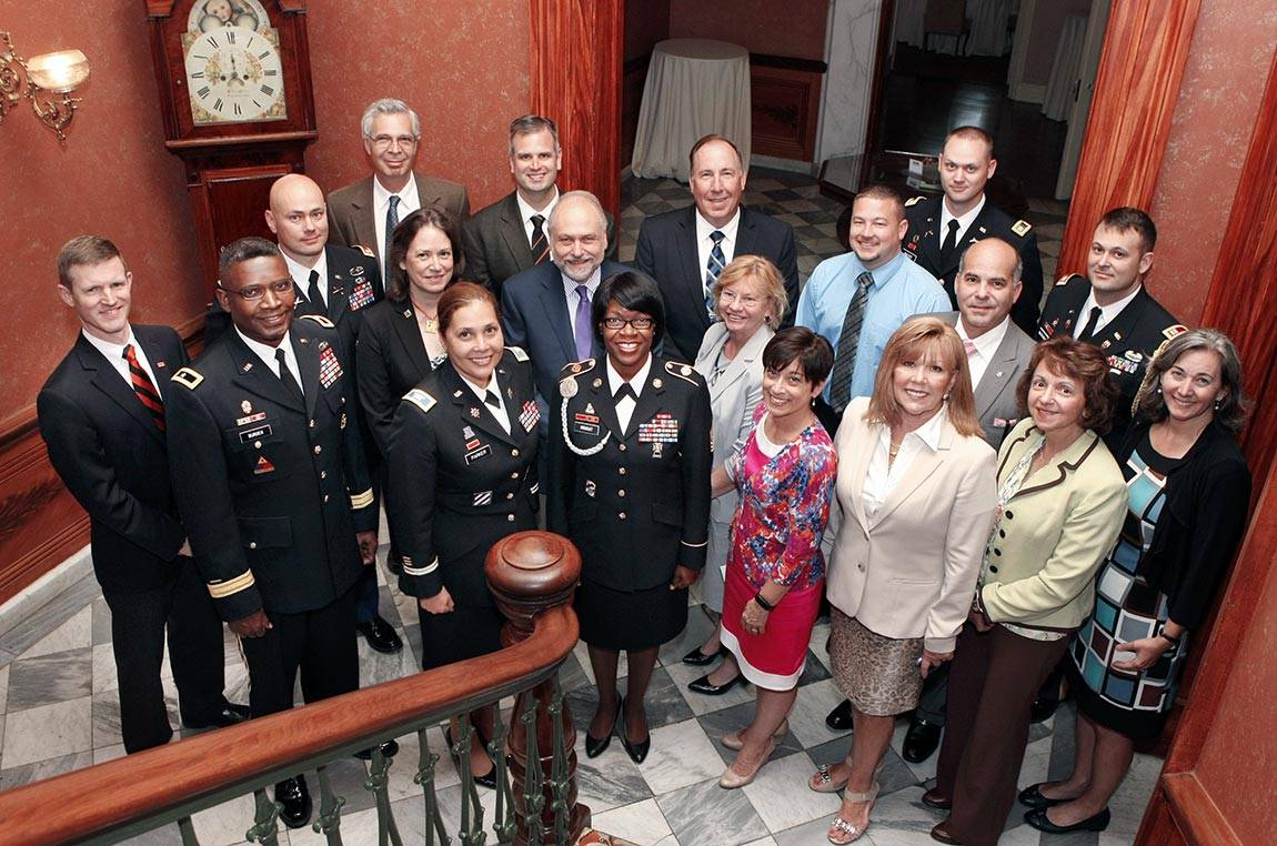 Representatives from Princeton and the Army gather in Prospect House on the Princeton campus on June 6.