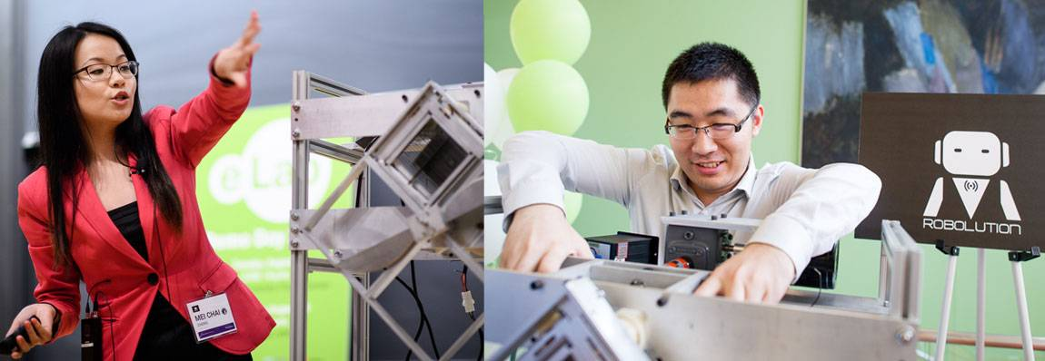 Robolution team members Mei Chai Zheng (left) and Weiqui Sun (right) discuss their invention