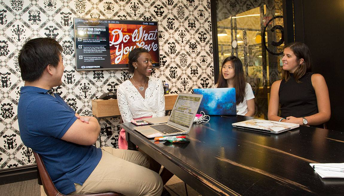 Princeton Start-Up Immersion Program Amos Chiou, digital strategist at Trendalytics, talks with juniors Victoria Scott, Denise Chan and Sarah Muse
