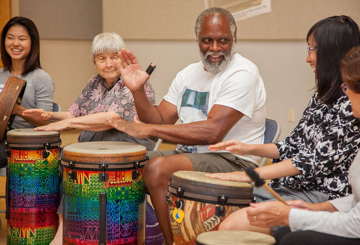 Princeton students with Seniors in drum circle