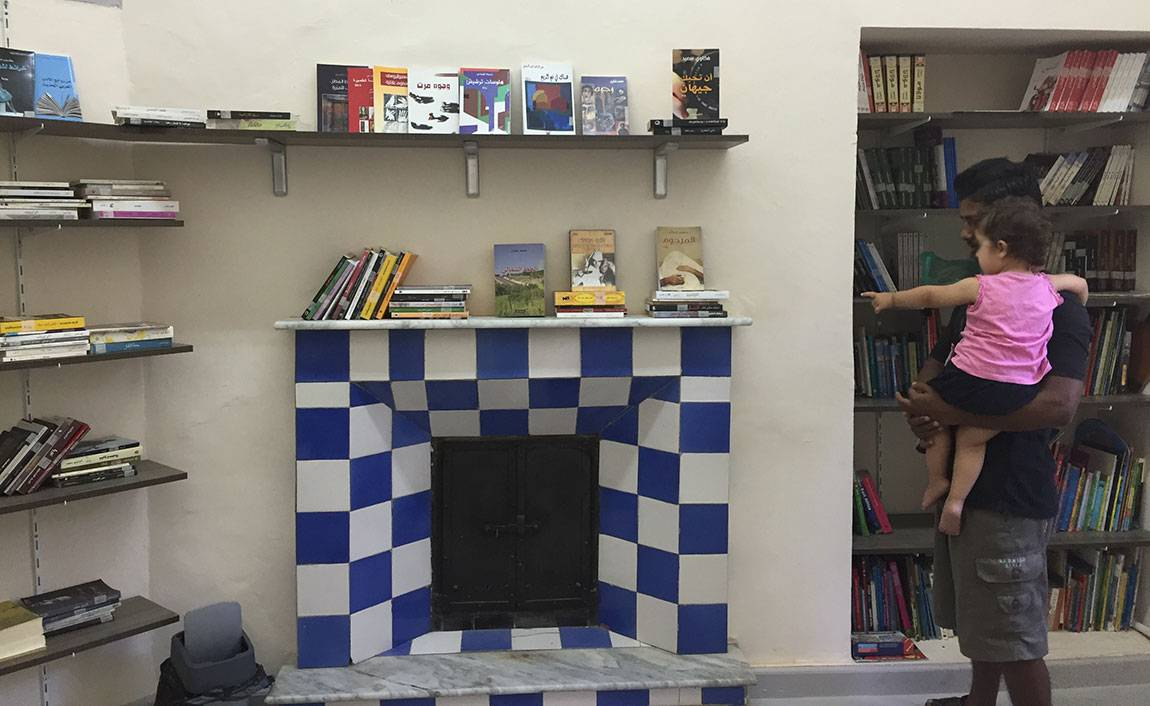 A Tale of Two Countries: Greece - a babysitter in library Mosaik Support Center for refugees