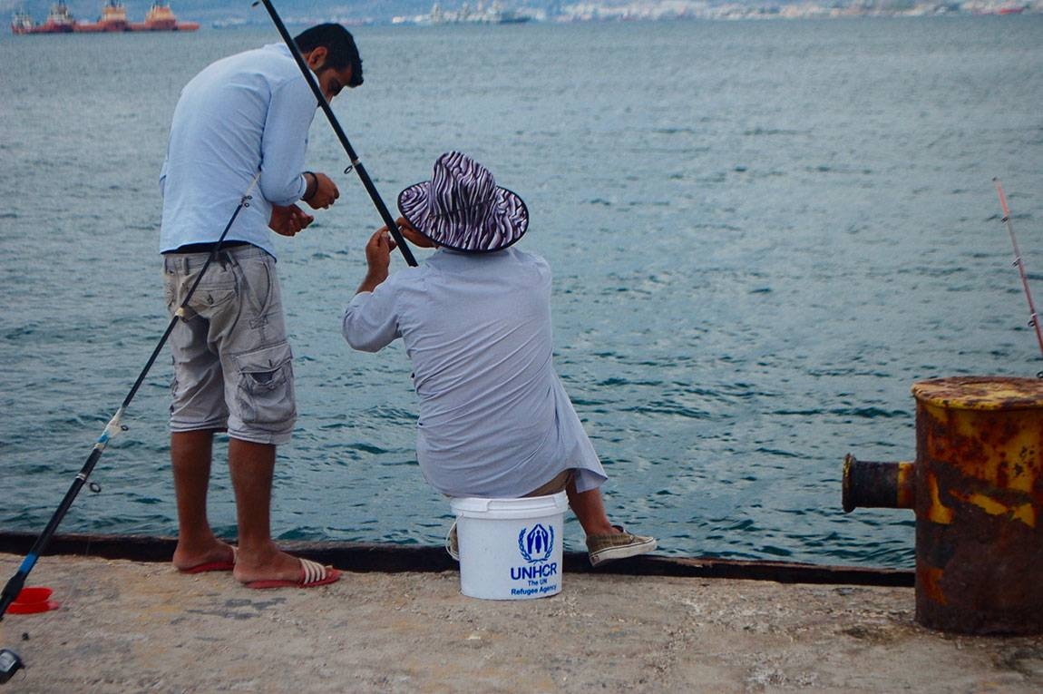 A Tale of Two Countries: Greece - fishing at Skramagas refugee camp